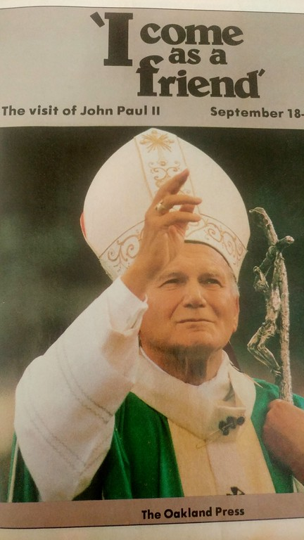 . The front page of a special edition of The Oakland Press for the visit of Pope Saint John Paul II to the Pontiac Silverdome in 1987.