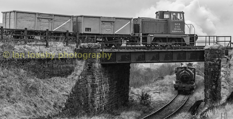 Empress brings another load of empties  up to furnace sidings whilst, no 14 awaits the road into the pit head