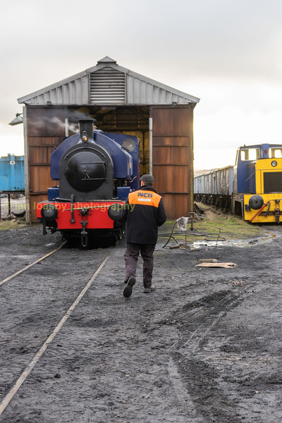 A  timeless scene, a   driver walking to his locomotive to start his shift.