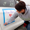East Elementary sixth grade teacher Jodi Brown decorates her van on Monday. Teachers from East Elementary paraded through their students' neighborhoods to encourage them on what would have been their first day back after spring break.
