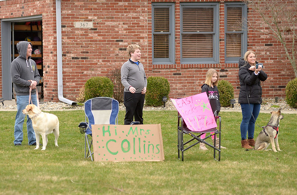 Teachers from East Elementary paraded through their students' neighborhoods to encourage them on what would have been their first day back after spring break on Monday.