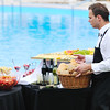 young people serving food on buffet wedding seminar or conference outdoor party with fresh food and dringks