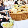 people choosing food from table on cattering and buffet party on business seminar conference or wedding