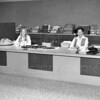 1st National Bank 1973<br /> Left Nancy Kellog     Right Betty Adams<br /> Lacy Photo<br /> 0014-6771