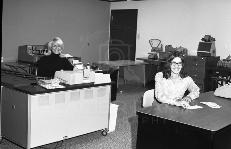1st National Bank 10/25/1973<br /> Left,  Connie Rice Mitchell   Right,  Judy Canzona Gepphart<br /> Lacy Photo<br /> 0011-6771