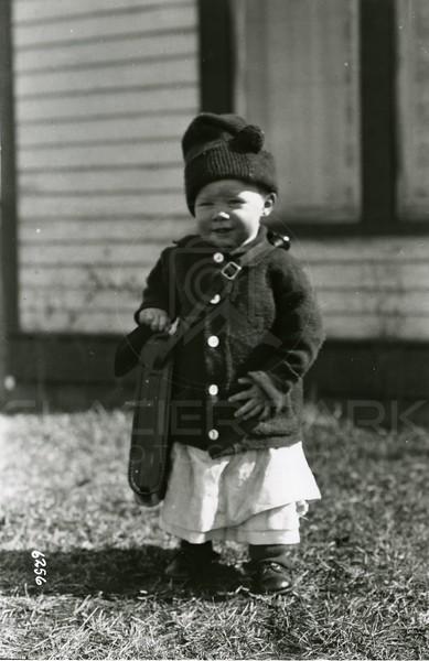 Ferde Greene Photo<br /> 3/24/1918 Ruby Greene with camera case<br /> 1/25 f11<br /> 6256