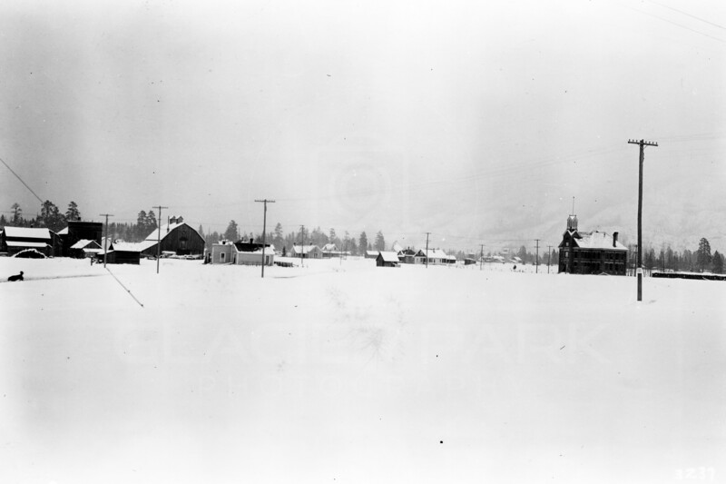 Ferde Greene Photo<br /> 4/3/1917 Columbia Falls, Montana building on the right is Columbus School built in 1892<br /> 3237