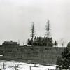 Ferde Greene Photo<br /> 2/11/1925, Talbot house with side of river near old steel bridge.  House burned down Kalispell, Montana<br /> 4400