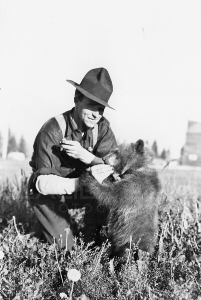 Ferde Greene Photo<br /> 7/10/1916 The grizzly with Ora Reeves, Columbia Falls<br /> 3229