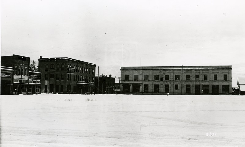 Ferde Greene Photo<br /> 2/20/1921 Gaylord Hotel on left, Bank building on Right, Columbia Falls, Montana<br /> 2331