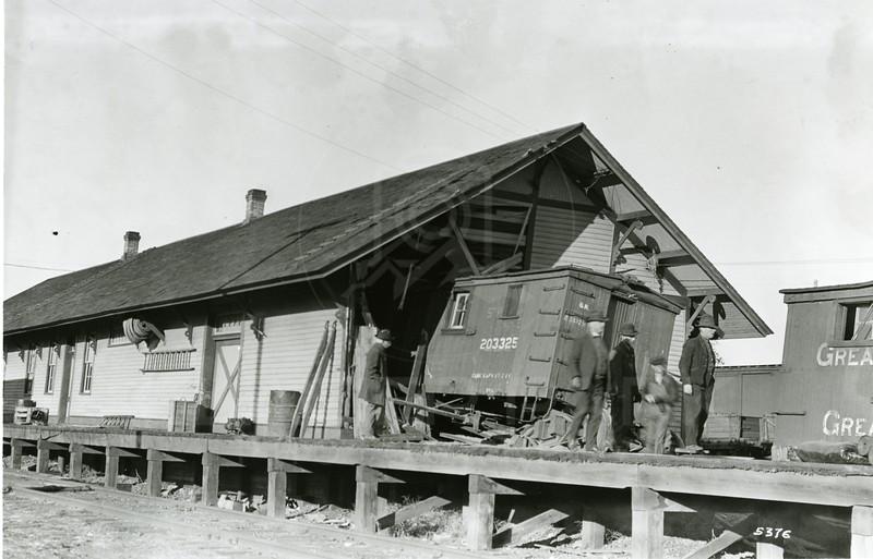 Ferde Greene Photo<br /> 10/25/1923 9:30 AM, Train crashes into depot, Columbia Falls, Montana<br /> f11 1/25<br /> 5376