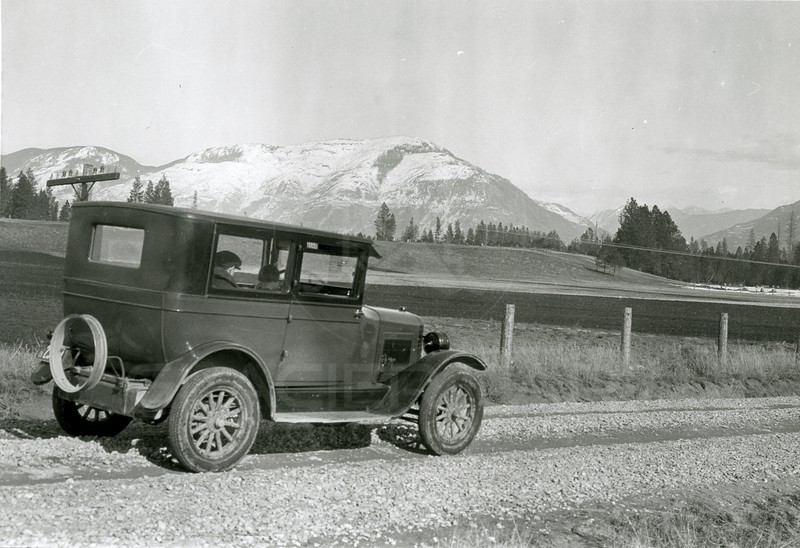 Ferde Greene Photo<br /> 2/20/1925 First picture of the new car, 1925 Overland, spare tire was not included, Columbia Falls Stage Road<br /> 4415