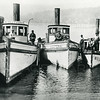 Tugboats at Somers, Montana ca 1925<br /> A Gutherie Captain Angus Mac Donald, <br /> Kootenai Captain is Geo Fletcher, <br /> Willis Captain is Bill Schuts (Descutts)<br /> The Kootenai was formerly the Cotter named for a son of John O'Brien Lumber Co. in 1901 and the first boat built in Somers, Montana<br /> Train White Photo