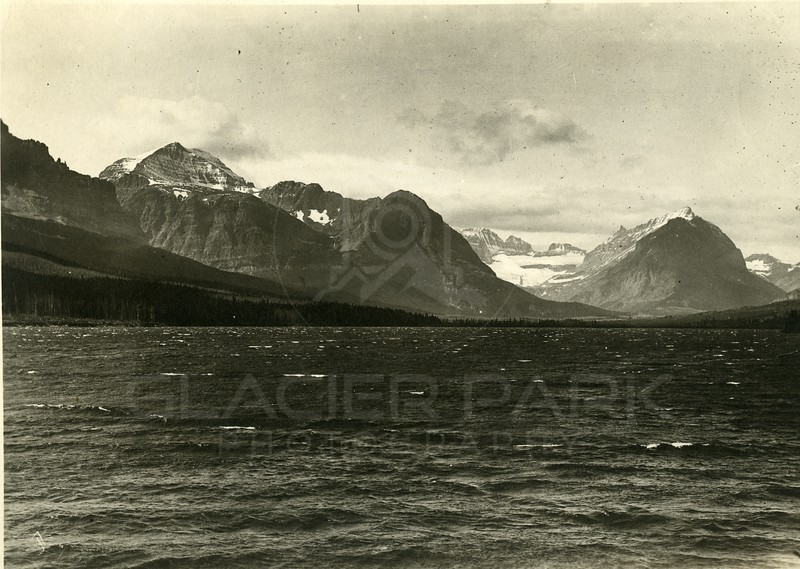 Sherburne Lake - Approach to Many Glacier Camp & Hotel<br /> Grinnell Glacier to the right center - 1913<br /> Dam just completed
