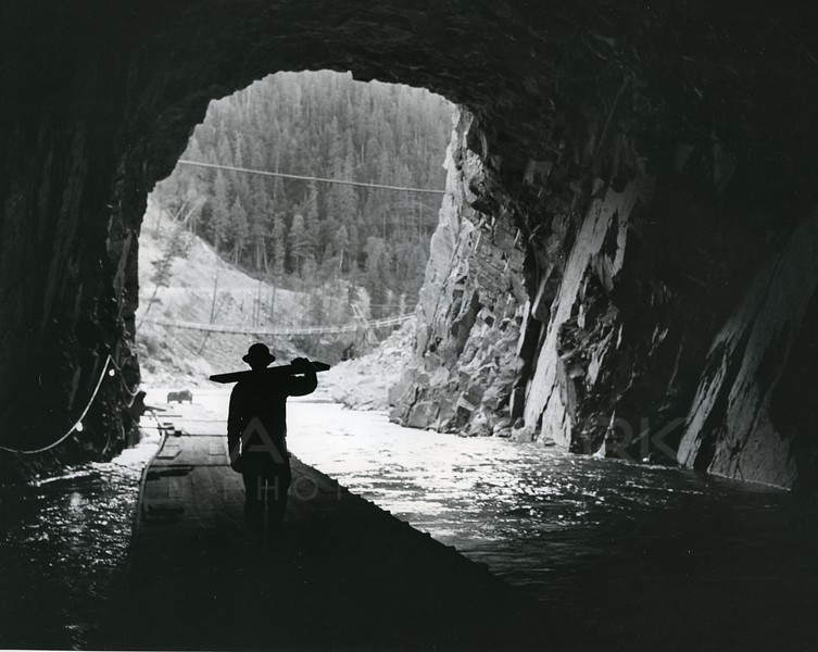Man walking with supplies for Hungry Horse Dam
