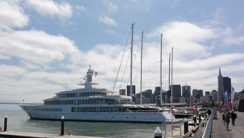 Larry Ellison's Musashi and sailing superyachts anchoring at the America's Cup village.