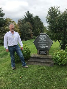 Michael Marcotte, at the monument placed in 1967 along route 138 in Neuville, to honor the brothers Nicolas and Jacques Marcotte, who farmed adjacent lands on the North bank of the St. Lawrence River, near this spot from about 1687 to 1701 for Jacques, and until 1704 for Nicolas. The marker was accidentally put in a spot about 1/4 mile east of the actual farms, due to the parish boundaries having been different 300 years ago than they were in 1967, when the marker was placed.