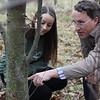Kristen Wickert and Matt Kasson points at Chestnut tree.<br /> 35214 WVU Mag American Chestnut<br /> WVU Photo/ Raymond Thompson<br /> WVU Magazine