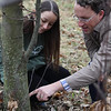 Kristen Wickert and Matt Kasson points at Chestnut tree.<br /> 35214 WVU Mag American Chestnut<br /> WVU Photo/ Raymond Thompson<br /> WVU Magazine