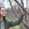 Kristen Wickert points at Chestnut tree.<br /> 35214 WVU Mag American Chestnut<br /> WVU Photo/ Raymond Thompson<br /> WVU Magazine