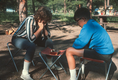 Dorothy And Wayne Playying checkers At South Meadows Campground In Pike National Forest. Colorado Vacation.  August, 1965