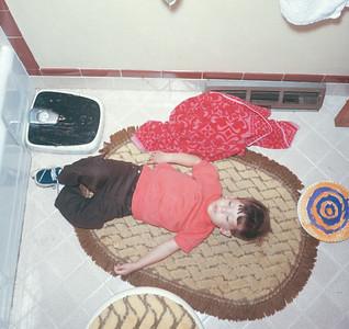 Billy Sleeping On Bathroom Floor, Platte City, MO, 1970