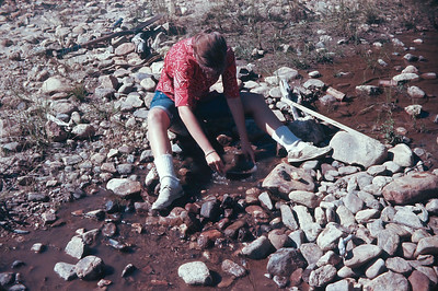 Chris Panning For Gold In Clear Creek.  Near Black Hawk, CO.  August 16, 1963