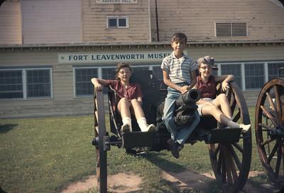 Chris, Wayne, and Unknown Sit On A Canon.  Fort Leavenworth Museum, Leavenworth, KS.  June 17, 1961