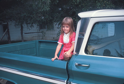 Theresa In A Truck At The Farm In Kansas. September 26, 1965
