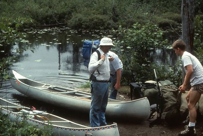 Dad carries both canoes ... look at the size of the back pack!