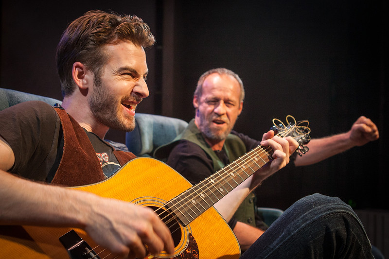 Word for Word's production of 36 Stories by Sam Shepard, at Z Below 5/21/14 through 6/22/14.  L to R: Patrick Alparone, Rod Gnapp. Photo by Mark LeialohaThe Writer (Rod Gnapp) is serenaded on his journey by The Musician (Patrick Alperone).