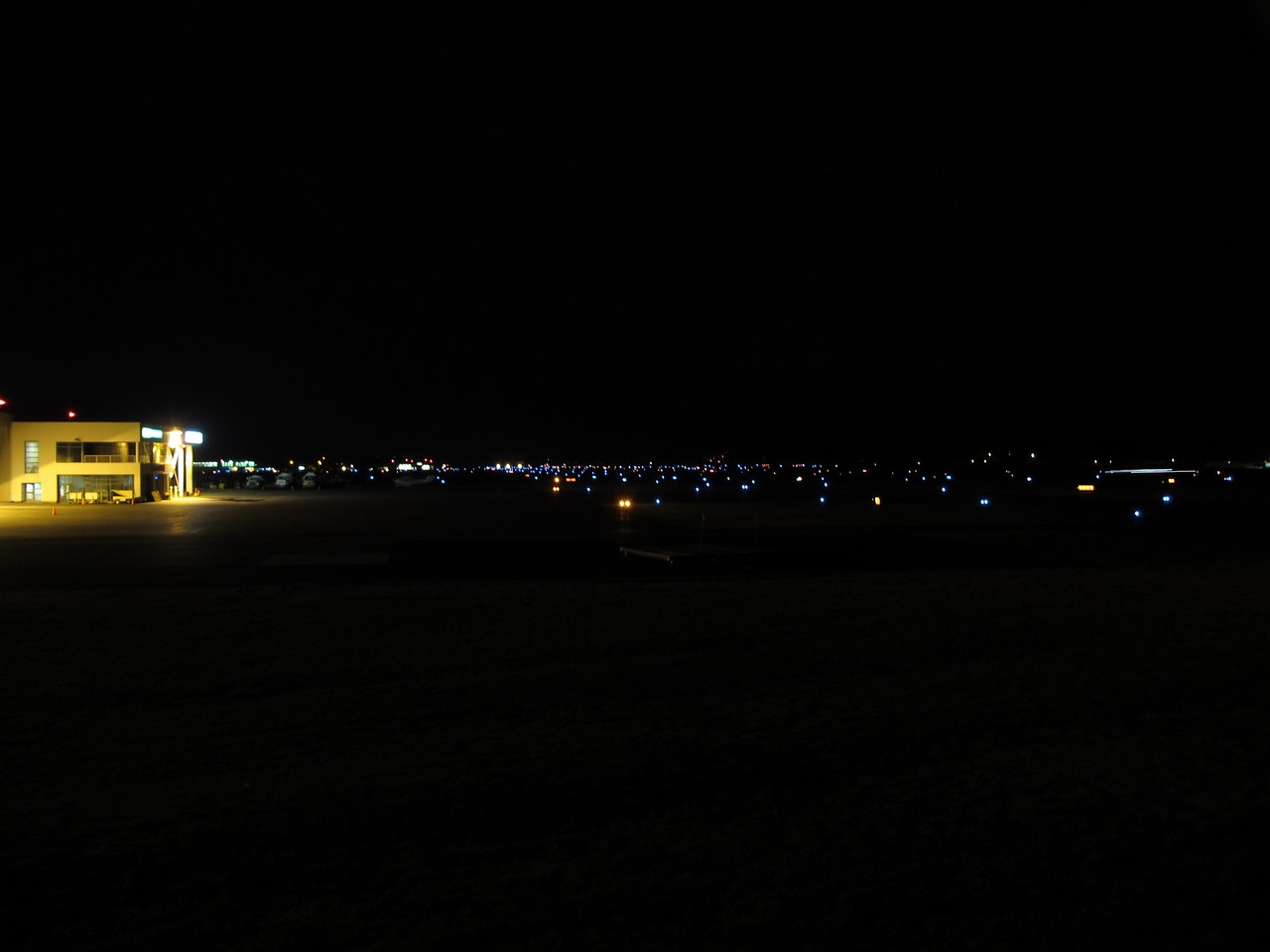 CYYJ.  This is runway 27, viewed about 1/8th of the way down, just south of the arrivals end.  I continue to try to get a better picture of this place at night.<br /> <br /> Victoria, BC.