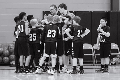 11 of 365 - In the huddle. Not the same environment as the Hope vs. Calvin game, but it means just as much to these guys. 6th grade basketball at its finest.
