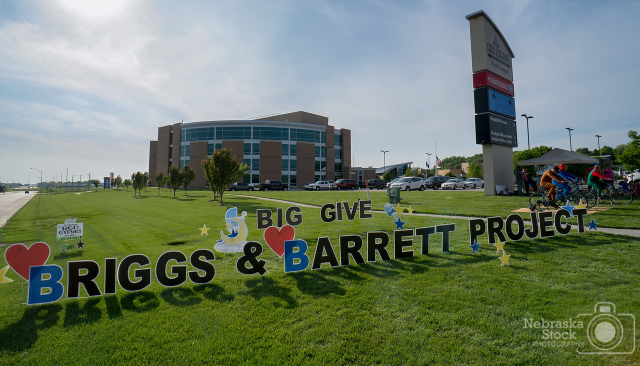 """5-22-2018<br /> 142/365<br /> """"The Briggs & Barrett Project""""<br /> Today FRHS Administration and employees along with community members biked to raise money for """"The Briggs & Barrett Project"""". The money raised from the fundraiser helps to provide newborn babies at Faith Regional Health Services with Halo Sleep Sacks and Sleep Baby: Safe and Sung Book to encourage babies to sleep on their backs and to provide SIDS Education to parents. Pictured above are members of Norfolk Fire and Rescue pedaling away to raise money for the project. <br /> Photo taken with a Sony A6300 with a Sony 16mm<br /> ISO 200<br /> 1/500th at F8<br /> (97224)"""