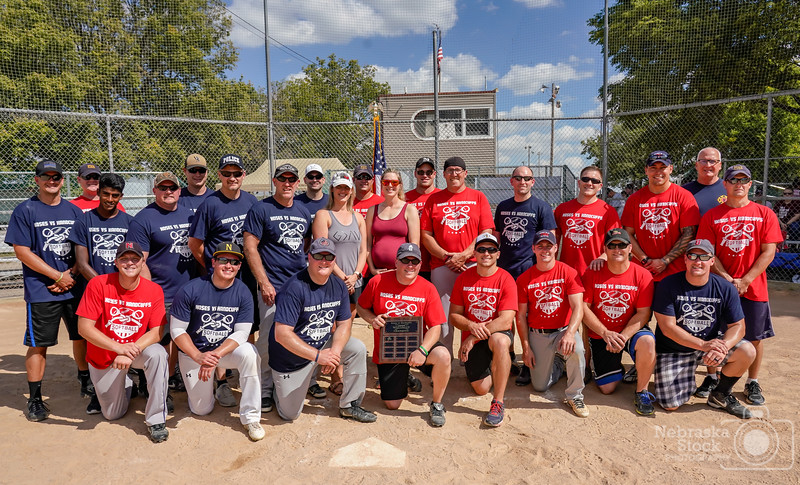 """9-16-2018<br /> <br /> 256/365<br /> <br /> """"Hoses vs Handcuffs""""<br /> <br /> Norfolk Fire and Rescue and the Norfolk Police held their annual softball game Sunday afternoon. The game helped raise money for the """"Brigg's and Barrett Project. Pictured are both teams Briggs mom Melissa West, Barrett mom, Allison Uecker<br /> <br /> Photo taken with a Sony A7rIII with a Sony FE 24-105<br /> <br /> ISO 640<br /> <br /> 1/2500th at F8<br /> <br /> (158417)"""