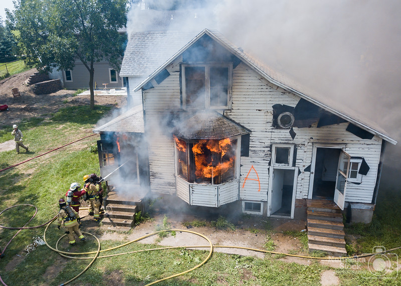 8-12-2018<br /> 224/365<br /> Members from several Northeast Nebraska fire departments met Sunday morning to practice their firefighting skills on an old farm house northwest of Norfolk. <br /> Photo taken with a DJI Mavic Pro<br /> ISO 100<br /> 1/610th at F2.2<br /> (140196)