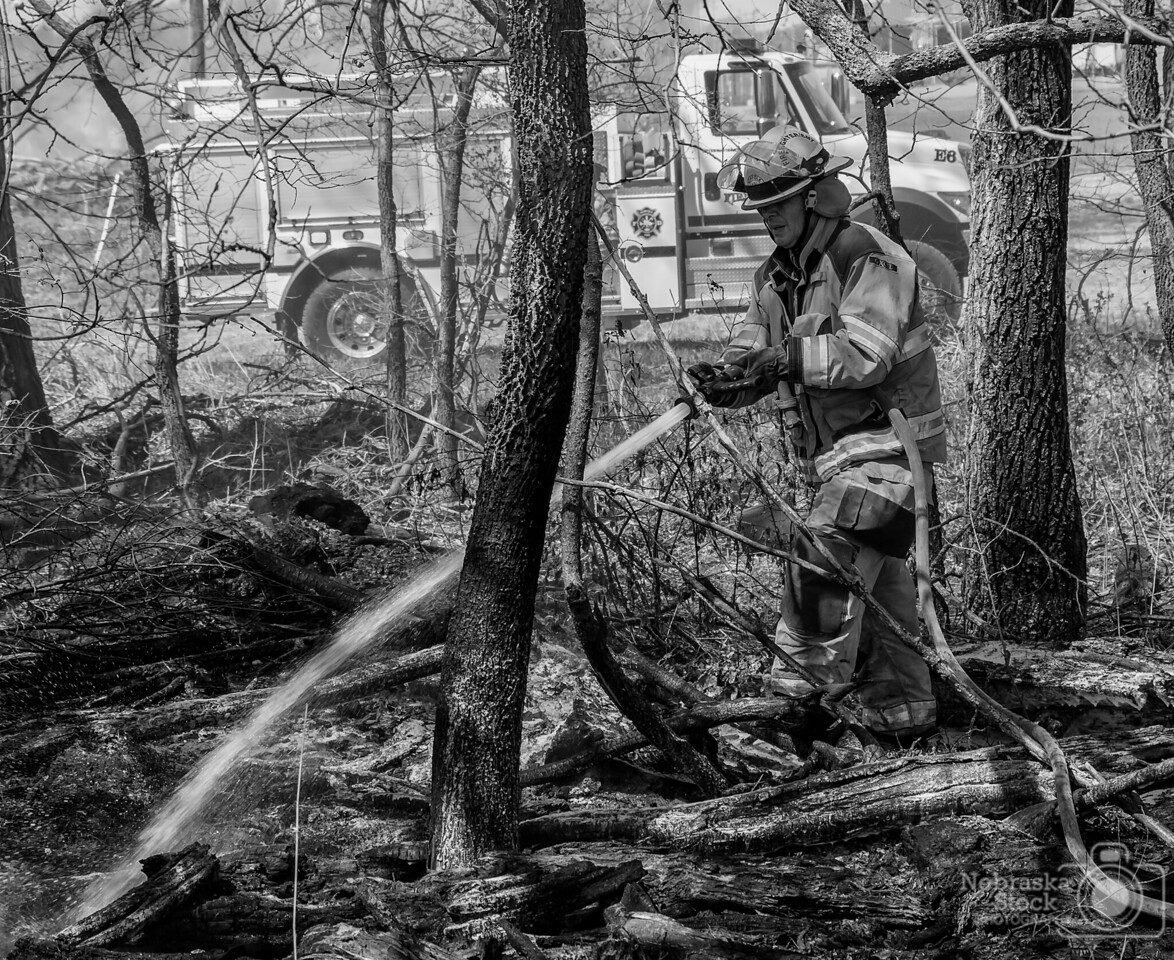 5-7-2018<br /> 127/365<br /> A Norfolk Firefighter works on putting out a fire that spread from a controlled burn Monday morning northeast of Norfolk. <br /> Photo taken with a Sony A6300 with a Sony 18-200<br /> ISO 250<br /> 1/350th at F6.7<br /> (85028)