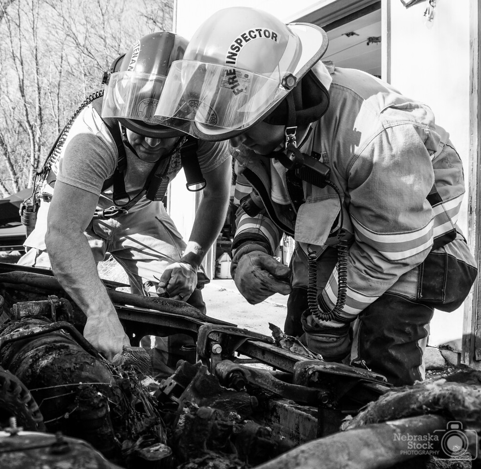 4-25-2018<br /> 115/365<br /> A couple of members of Norfolk Fire inspect what is left of a vehicle after it caught on fire Wednesday afternoon. A passerby and off duty Norfolk Firemedic prevented the car fire from spreading to the nearby house. <br /> Photo taken with a Sony A6300 with a Sony 18-200<br /> ISO 400<br /> 1/350th at F5.6<br /> (64699)
