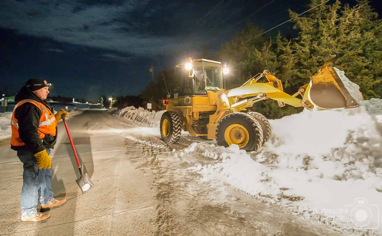 1-29-2018<br /> 29/365<br /> Pierce's 2nd Assistant Fire Chief, Rod Schwartz, watches Pierce's Fire Chief, Steve Dolesh move snow away from a fire hydrant with a loader Monday night. Members of the Pierce Fire Department went around Pierce Monday night and cleared all the snow from last week snow storm away from the fire hydrants.  <br /> Photo taken with Nikon D4 with Tamron 15-30 Wide <br /> ISO 20000<br /> 1/60th at F2.8<br /> (12593)