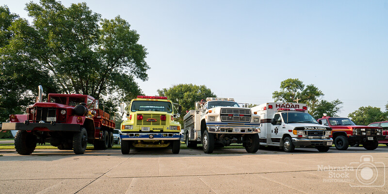 8-11-2018<br /> 223/365<br /> The line up of truck of the Hadar Fire Department sits across the street from their home as the Hadar Firefighters host their annual fundraiser BBQ. <br /> Photo taken with a Sony A6300 with a Sony 16mm<br /> ISO 250<br /> 1/250th at F8<br /> (139687)