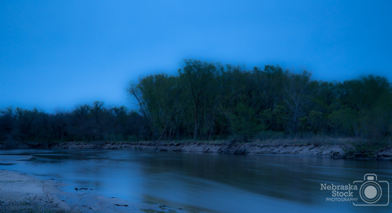 5-10-2018<br /> 130/365<br /> The wind coming from the north late last night was pushing the river and blowing the cottonwood trees quit a bit to capture the movement of Mother Nature. <br /> Photo taken with a Sony A6300 with a Sony 18-105<br /> ISO 100<br /> 15 second at F11<br /> (85223)