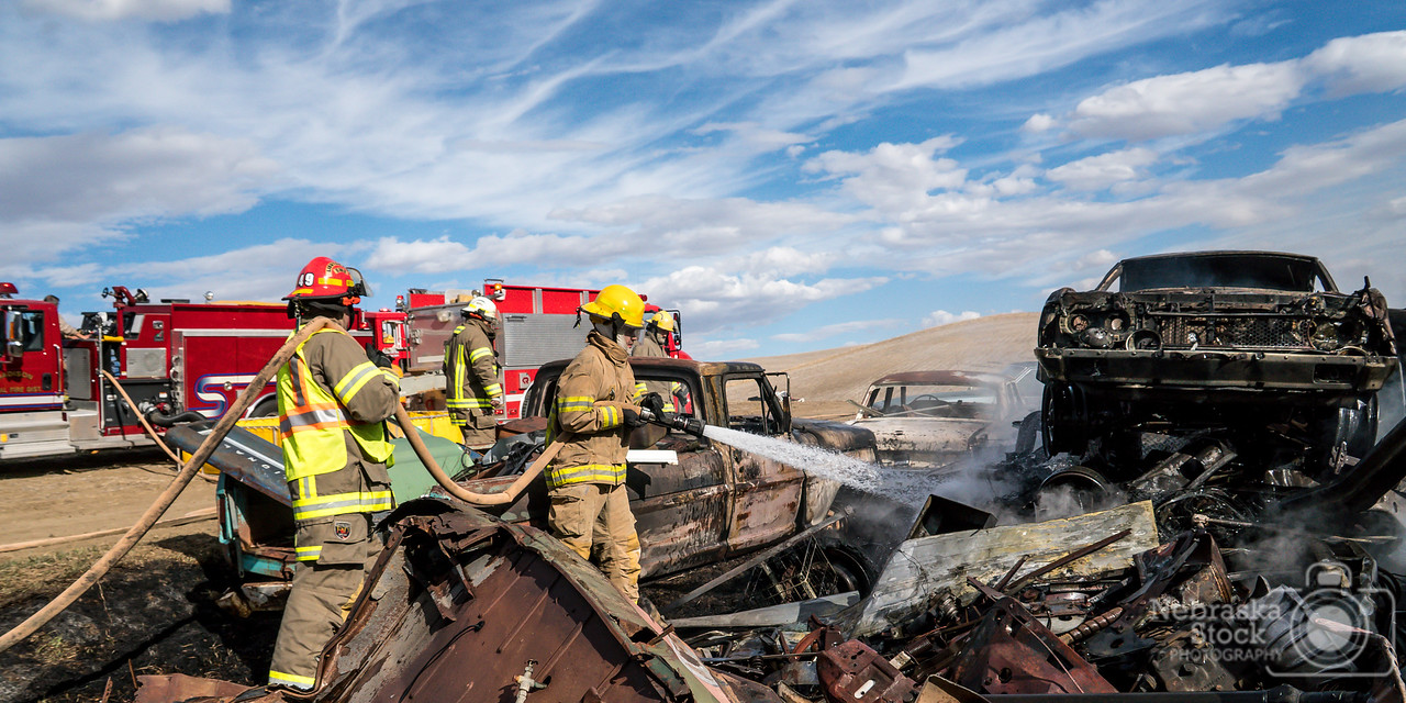 4-10-2018<br /> 100/365<br /> Madison Firefighters fight a grass fire among the cars in this junk yard east of Madison. Stanton Fire was called in to assist with a couple of tanker. <br /> Photo was taken with a Sony A6300 with a Sony 18-200<br /> ISO 400<br /> 1/3000th at F6.7<br /> (55935)