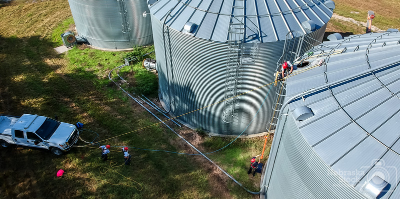 9-11-2018<br /> <br /> 254/365<br /> <br /> Members with Norfolk Fire & Rescue work on getting equipment up on top of a bin Tuesday morning during a grain bin rescue training drill. <br /> <br /> Photo taken with a DJI Spark<br /> <br /> ISO 100<br /> <br /> 1/800th at F2.6<br /> <br /> (153337)