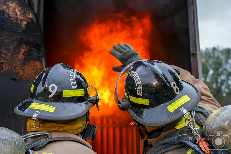 9-30-2018<br /> <br /> 273/365<br /> <br /> The Pierce Fire Department started a Cadet Training program a few months ago. Pictured here is a Pierce Firefighter showing the ropes of live burn with a SCBA with a new cadet Sunday evening. <br /> <br /> Photo taken with a Sony A9 with a Sony FE 24-105<br /> <br /> ISO 2500<br /> <br /> 1/320th at F4<br /> <br /> (169817)