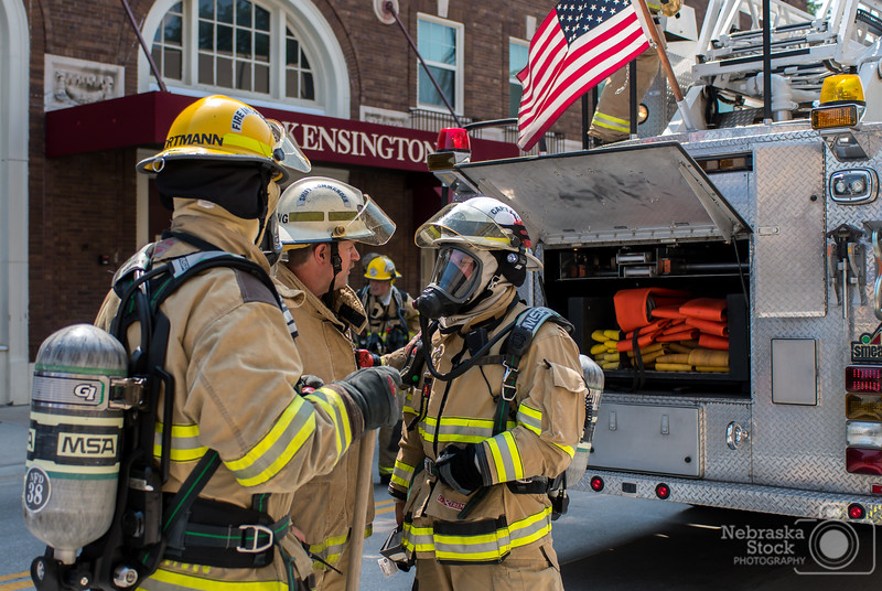 6-29-2018<br /> 180/365<br /> Members of Norfolk Fire discuss a plan of attack on a fire scene Friday morning downtown Norfolk. <br /> Photo taken with a Nikon D500 with a Nikon 28-70mm<br /> ISO 320<br /> 1/3200 at F2.8<br /> (110832)