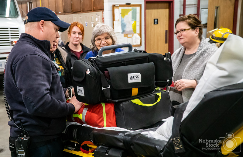 10-7-2018<br /> <br /> 280/365<br /> <br /> Norfolk's Firemedic Sam Funk shows some guest some rescue equipment Sunday afternoon during Norfolk Fire at Rescues Open House at Station 1. Norfolk Fire and Rescue hosted their annual open house to kick off Fire Prevention month. <br /> <br /> Photo taken with a Sony A6300 with a Sony 18-105<br /> <br /> ISO 5000<br /> <br /> 1/200th at F4<br /> <br /> (175735)
