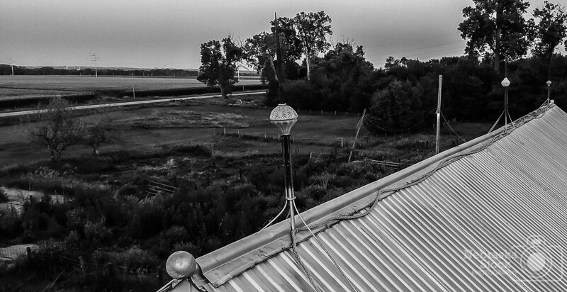 """7-11-2018<br /> 192/365<br /> All of our old barns still have their """"Lighting Rod Balls"""" still intact like they were put up yesterday. Pretty amazing that they have lasted the many years that they have lasted. <br /> Photo taken with a DJI Spark<br /> ISO 200<br /> 1/60th at F2.6<br /> (114690)"""