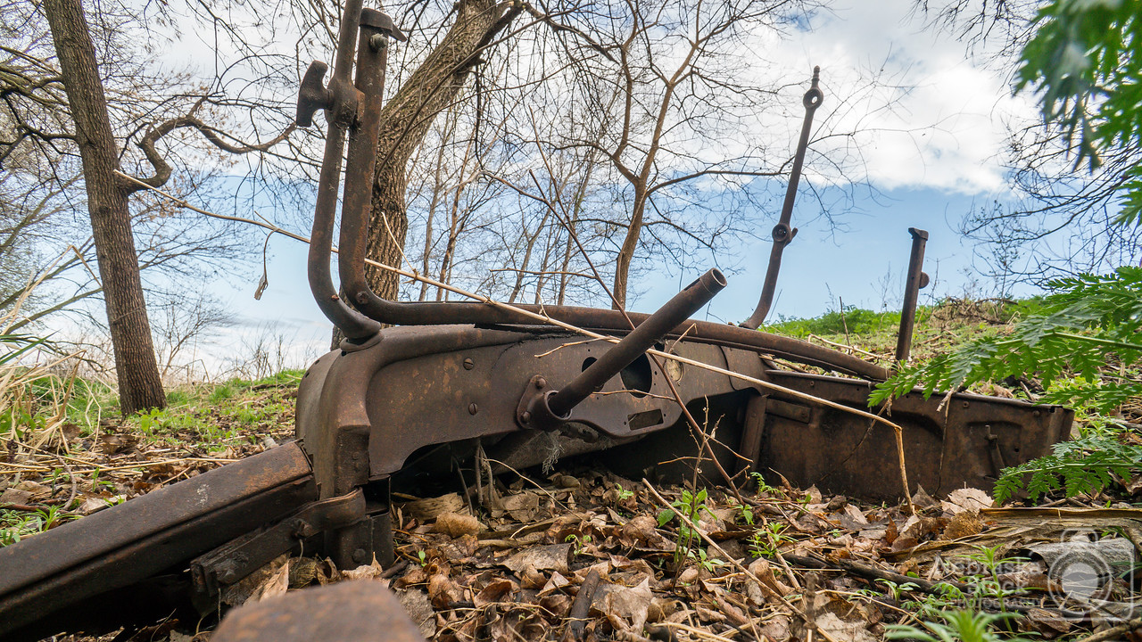 5-03-2018<br /> 123/365<br /> As I walked around this old car that is buried in the dirt next to the river to photograph it, I find myself wondering what kind of stories this old piece of history could tell me, and how it ended up along the Elkhorn River? Oh what we all could learn if old iron could talk...<br /> Photo taken with a Sony A6300 with a Sony 16mm<br /> ISO 400<br /> 1/125th at F8<br /> (78810)