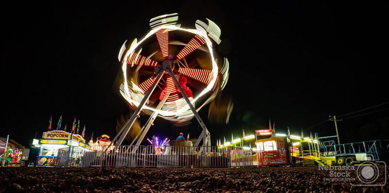 8-4-2018<br /> 216/365<br /> The night time lights of The Stanton County Fair. <br /> Photo taken with a Sony A6300 with a Sony 16mm<br /> ISO 200<br /> 1.5 seconds at F8<br /> (136833)