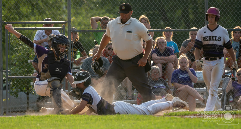 7-15-2018<br /> 196/365<br /> Austin Coffin from SOS beats the tag at home plate by Owen Lade of Battle Creek during the American Legion Junior Tournament held in Battle Creek Sunday afternoon. SOS went on to defeat Battle Creek in 6 innings to advance in the tournament. <br /> Photo taken with a Sony A7rIII with a Sony FE 100-400<br /> ISO 800<br /> 1/800th at F8<br /> (116144)